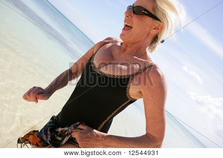 Portrait of a senior woman running on the beach
