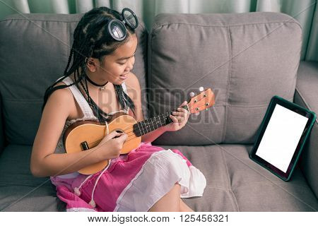 Happy Smiling Girl Learning To Play The Music