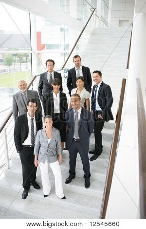 Group of business people smiling standing on stairs