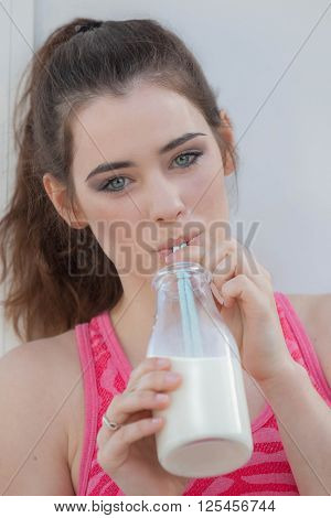healthy woman drinking dairy milk
