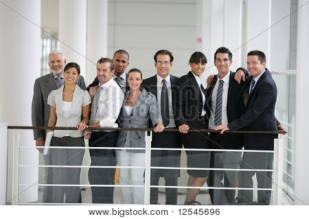 Group of business people smiling inside a society