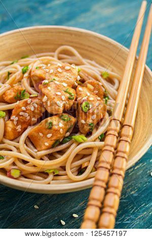 Chicken with noodles close up. Asian food