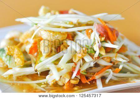 spicy salad or Thai salad with crispy pork