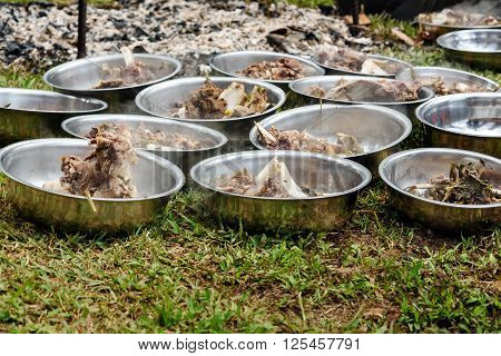 Hot Cooked Buffalo Meat In The Plates At The Funeral Ceremony In Tana Toraja