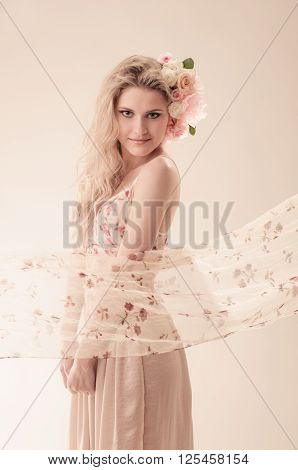 beautiful woman in flying dress on light backgroung