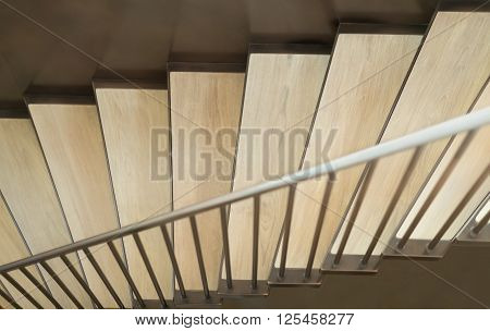 Beautiful stairway consists of brass and wood in luxury home. Selective focus.