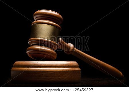 Wooden gavel isolated on black