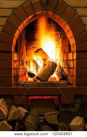 Firewood And Fire In Fireplace