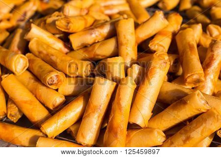 Pile of fried Malaysian spring roles on a local market in Malaysia