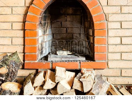 Not Kindled Brick Fireplace And Firewoods