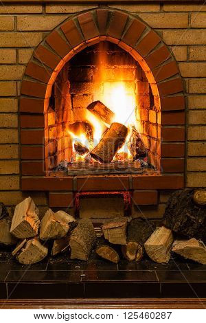 Wood And Fire In Fireplace