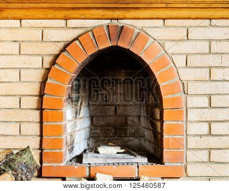 fire-box of not kindled brick fireplace indoor
