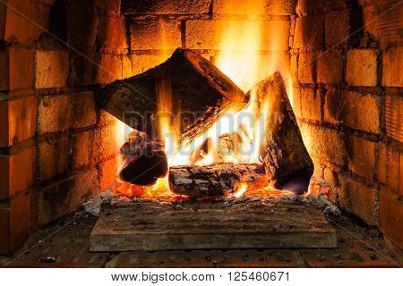 Burning Wood In Fire-box Of Fireplace
