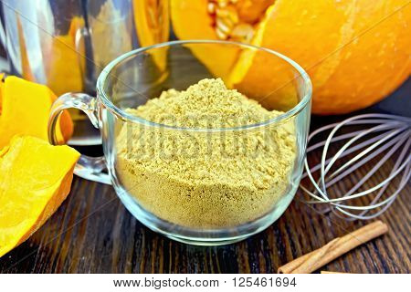 Flour Pumpkin In Glass Cup With Sieve And A Mixer On Board