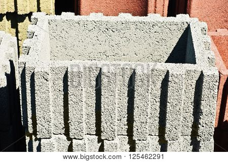 Background of stack concrete grey adn red block
