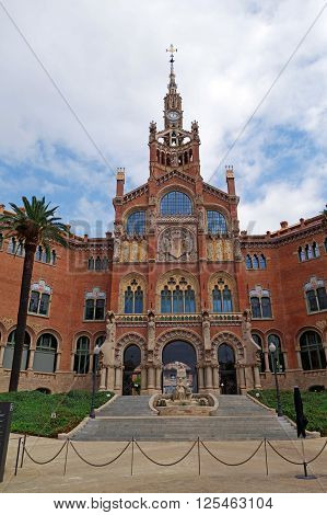 BARCELONA, SPAIN - AUGUST 1, 2015: View of the famous historical complex of former monastery and hospital Sant Pau Recinte Modernista, built between 1905-1930, designed by Lluis Domenech i Montaner.