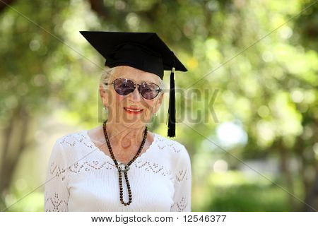 Happy Senior Woman In Graduate Cap