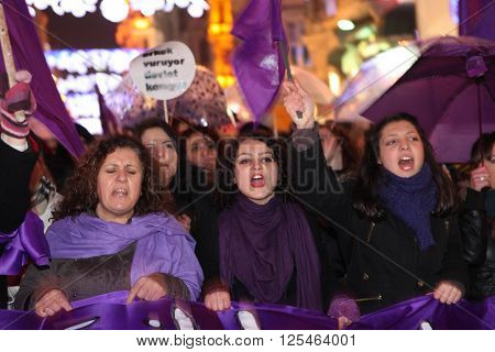 ISTANBUL,TURKEY-MARCH 8, 2012: Unidentified woman in purple costume celebrates international women's day on March 8,2012,in Istanbul,Turkey
