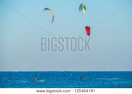 MARSA ALAM, EGYPT, MARCH 31, 2016: Kitesurfing in the waves of Red Sea