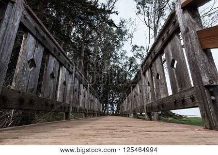 Wooden Bridge Walkway By Ocean From Low Angle