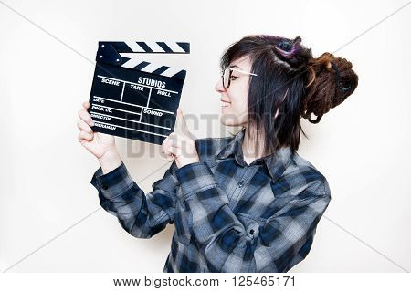 Smiling Teen Woman And Movie Clapper Board On White