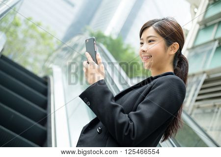 Businesswoman use of mobile phone