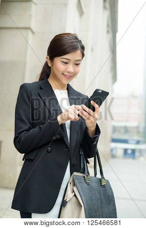 Business woman reply sms on cellphone