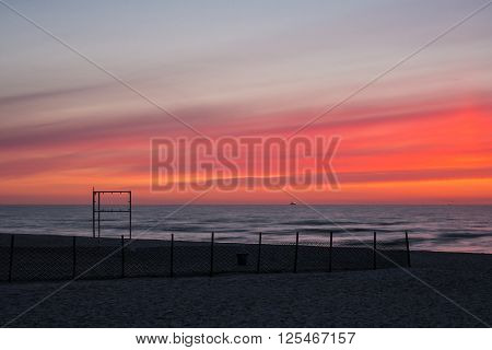 Sunset on the beach of Warnemuende (Germany).