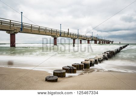 Pier on the Baltic Sea coast in Zingst (Germany).