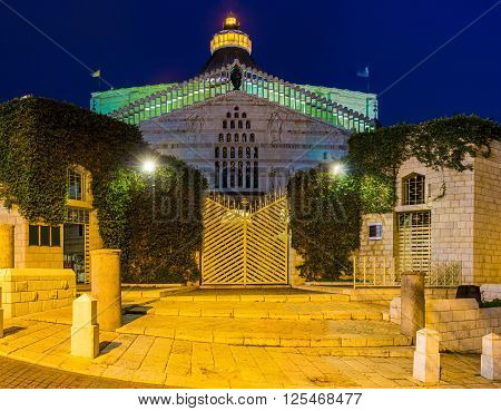 The beautiful illumination of the main landmark of the city - the Basilica of Annunciation in Nazareth Israel.