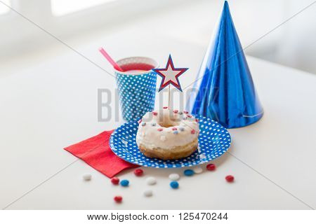 american independence day, celebration, patriotism and holidays concept - close up of glazed sweet donut with juice and candies in disposable tableware at 4th july party
