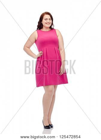female, gender, portrait and people concept - smiling happy young plus size woman posing in pink dress