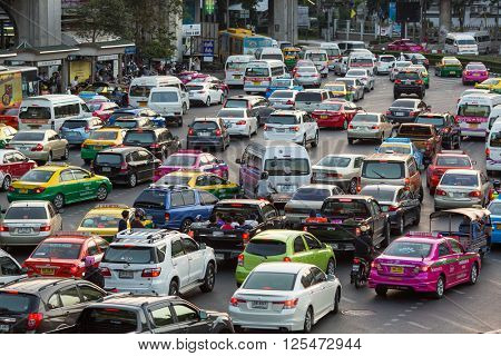 BANGKOK, THAILAND - APR 9, 2016: Rush hour of traffic circle near the Victory Monument BTS Station. Located in Ratchathewi District, northeast of central Bangkok.