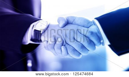 Handshake and a city. Abstract business concept.