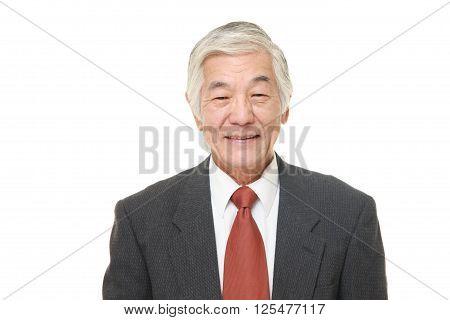 studio shot of senior Japanese businessman smiles