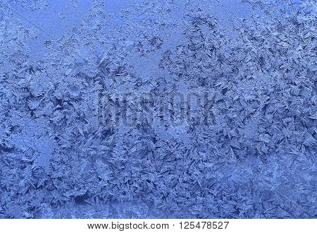 Texture of natural ice pattern on winter glass