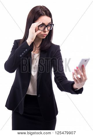 Bad News Concept - Surprised Business Woman Lookint At Smart Phone Isolated On White