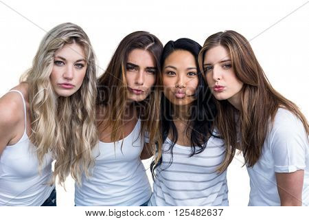 Multiethnic women making funny faces on white background