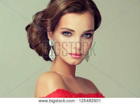 Beautiful stylish woman with glamour make up and hairstyle  with  jewelry big earrings