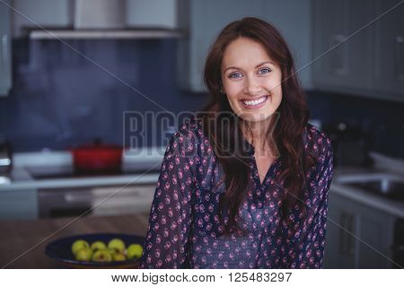 Beautiful woman smiling in kitchen at home