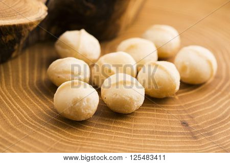 Roasted Macadamia Nuts On Rustic Wooden Background
