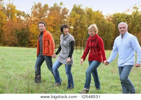 Portrait of men and women having a walk in the countryside