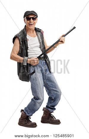 Full length portrait of a senior punk rocker pretending to play guitar on his cane isolated on white background