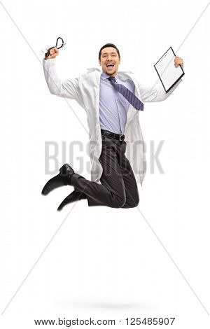 Vertical shot of an overjoyed doctor holding a clipboard and jumping out of joy shot in mid-air isolated on white background