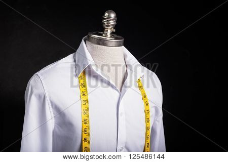 Shirt and measurement tape in studio set up