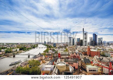 Panoramic view on Frankfurt skyline and Romerberg City Hall Square in Frankfurt in Germany. The Romerberg consists of old houses. Tourists nearby