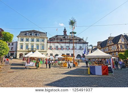 LINZ AM RHEIN GERMANY - MAY 4 2013: City Hall and Street market on Marktplatz in Linz am Rhein in Rhineland-Palatinate in Germany. Square in the City center. Tourists around.