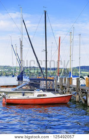 Pier and boats in Reichenau Island on Lake Constance. Reichenau is an island in Baden-Wurttemberg in Germany. It is under the UNESCO protection.