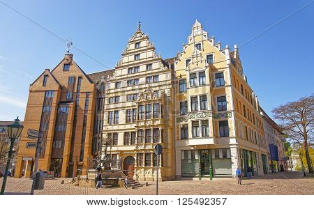 Street view on Leibniz house and fountain on Wooden Market Square Holzmarkt in Hanover in Germany. Hannover or Hannover is a city in Lower Saxony of Germany. Tourists nearby