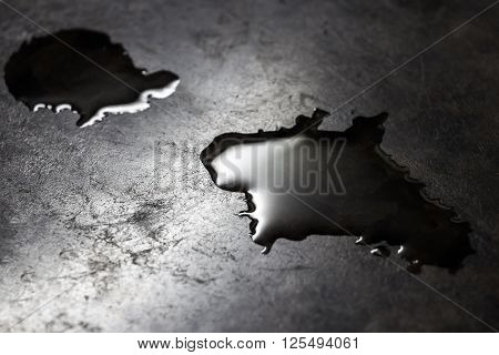 Water is poured on a black kitchen counter